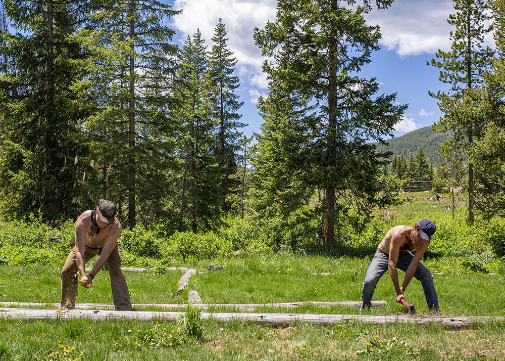 Ranchers in the Roaring Fork Valley working hard to maintain fencing on the ranch ; Engel & Völkers Real Estate