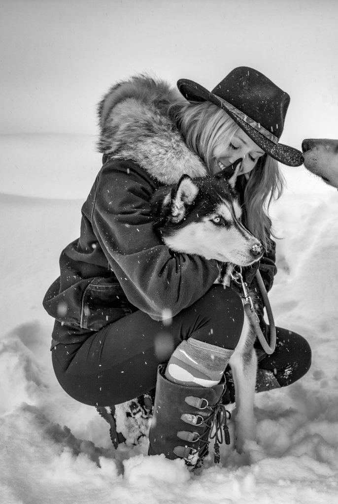 Kristin hugging her dog Colorado lifestyle