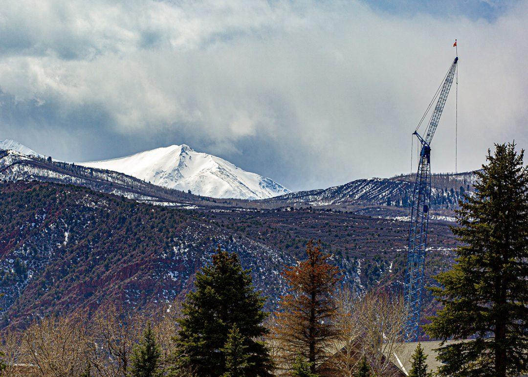 Mid-Roaring Fork Valley Developments, Engel & Völkers Real Estate, Crane In Front of Mt. Sopris, Photo by Tenley Steinke
