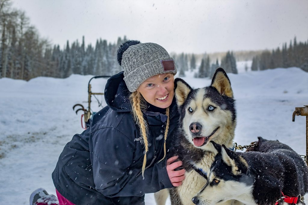 marketing director with dog sled team member